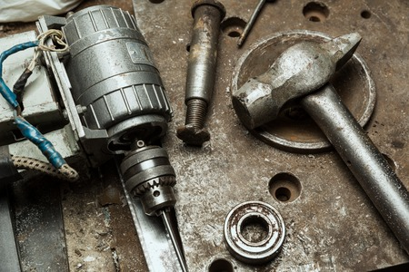 Old drill machine, hammer, machanic tools in the workshop