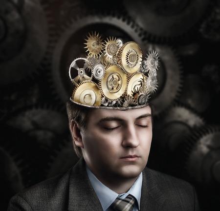 head gear: Man with cogwheel mechanism in his brain