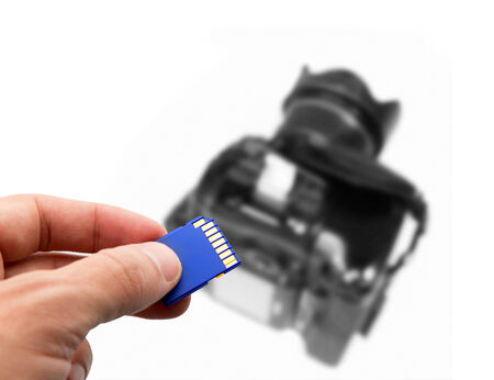 drive nail: Flash card in hand  with the camera in the background