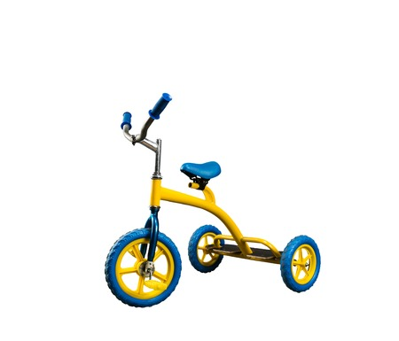 Vintage yellow kid\'s bicycle isolated on white