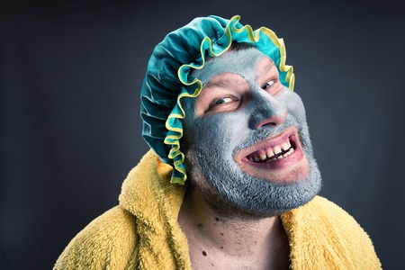 Crazy man with face pack. Closeup view Stock Photo