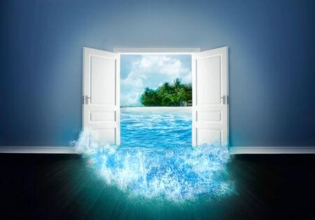 white door: White wide door open to the beach Stock Photo