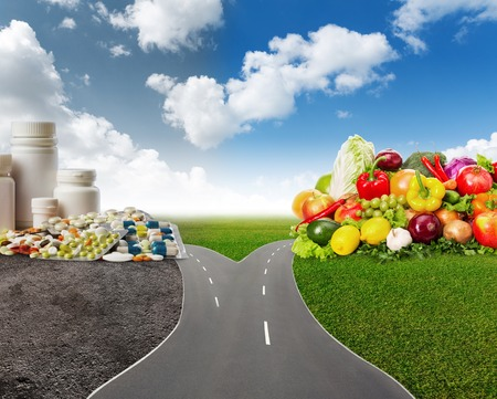 Choice between healthy food or medical pills Stock Photo