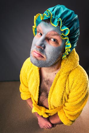 Sad freak man in bathrobe