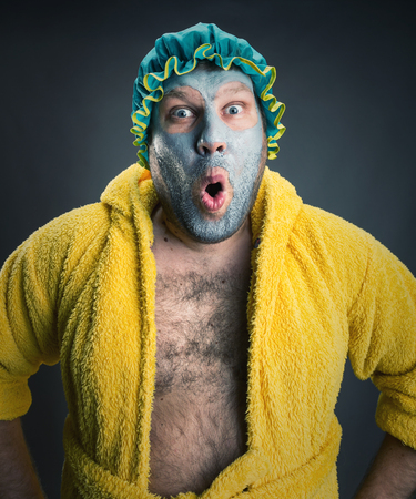 Surprised crazy man with face pack photo