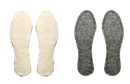 insoles: Two pairs of new insoles for shoes isolated on a white background Stock Photo