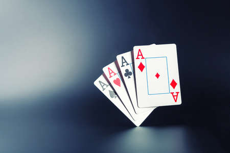 Four aces on dark background photo