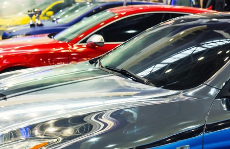 Close up of different cars in a row photo