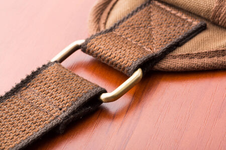 buckled: A close up of metal backpack buckle