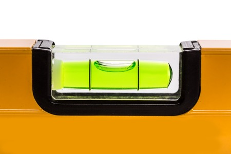 leveler: A closeup of green bubble level