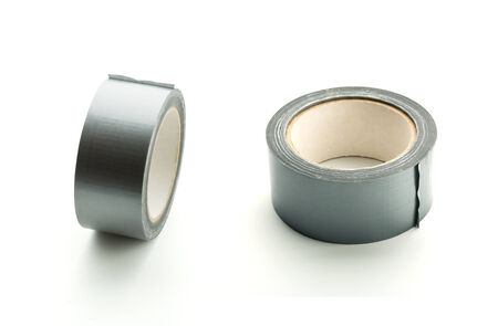 packing supplies: Two rolls of silver adhesive tape on white background