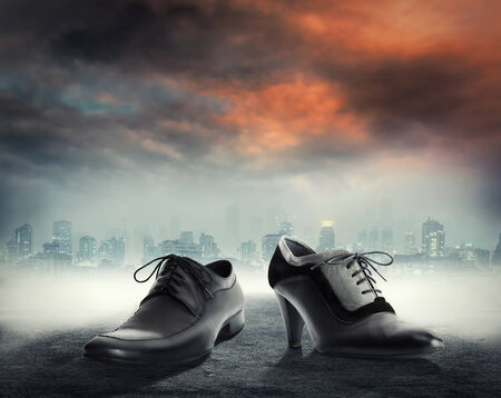 footgear: Elegant male and female dress shoes against city background