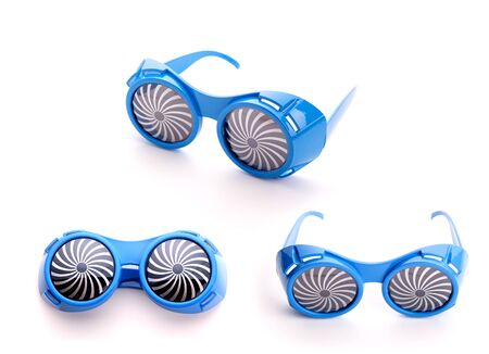 Three pair of party blue glasses for party on white background photo