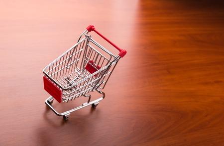 pushcart: Supermarket trolley on the wooden floor