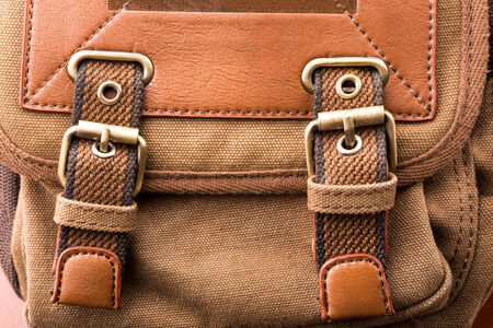 buckled: A close up of brown backpack buckle Stock Photo