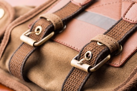buckled: Closeup of brown backpack buckles