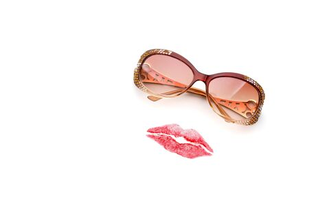 Glasses and lips forming woman face on white background photo