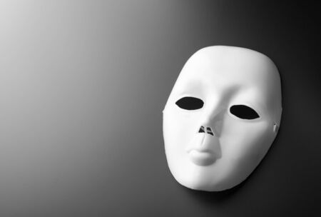 showpiece: Macro of theater mask on grey background