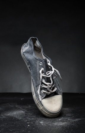 trainer: Old sport trainer on the grey floor Stock Photo