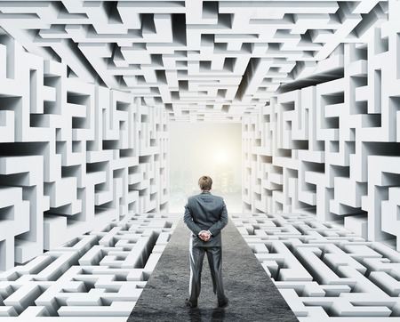 daily life: Businessman standing in labyrinth, facing difficulties in business and the stress of daily life Stock Photo