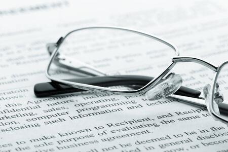 closeup: Closeup of glasses on the newspaper