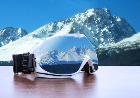 ski mask: White ski glasses against winter mountains