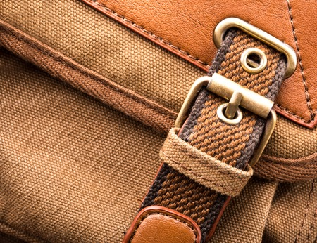 buckled: A closeup of brown backpack buckle
