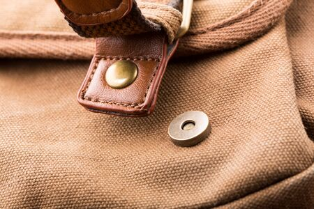 buckled: Closeup view of brown backpack buckle