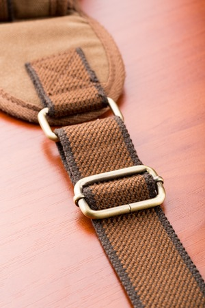 buckled: A closeup of metal backpack buckle