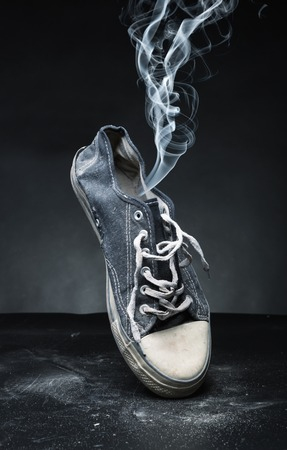 proceeds: Old gym-shoe from which the smoke proceeds
