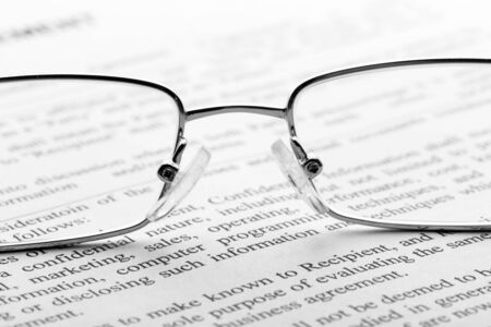 tabloid: Macro of glasses on the newspaper Stock Photo