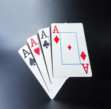 aces: Four aces on dark background. Toned Stock Photo