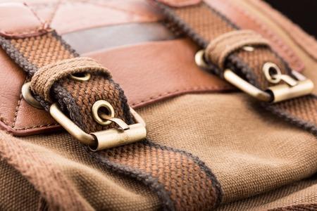 haversack: Macro of brown bag buckles