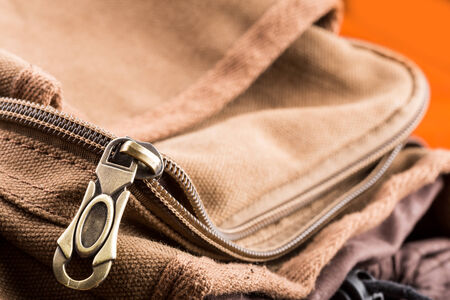 fabric bag: Macro of brown bag with open zipper Stock Photo