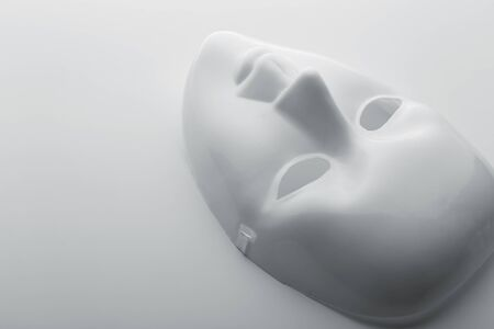 showpiece: Closeup of white face mask Stock Photo