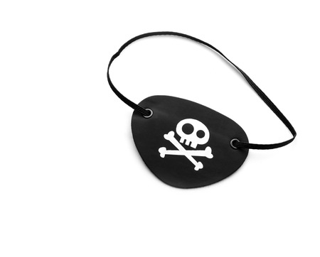 eyepiece: Closeup of pirate eyepatch isolated on white background