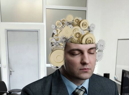 chock: Man with construction of bearing in his brain in the office