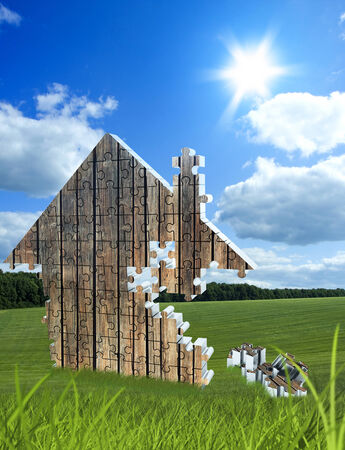 non urban: House consisting of wooden puzzles on the beautiful meadow Stock Photo