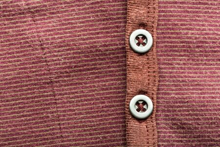 t short: A brown jacket background with buttons