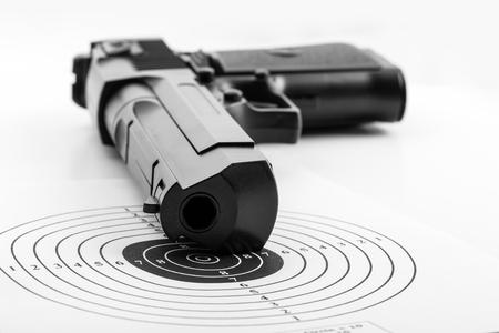 airgun: Paper target and airgun on white
