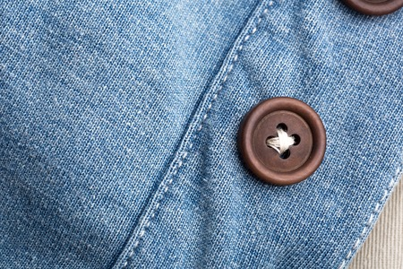 Closeup of jean cloth with plastic buttons Stock Photo