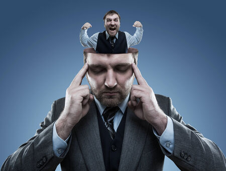 odd jobs: Crazy man in the head of young businessman on blue