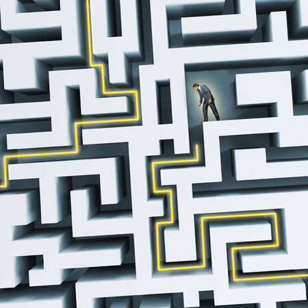 learning concept: Businessman standing in labyrinth, facing difficulties in business