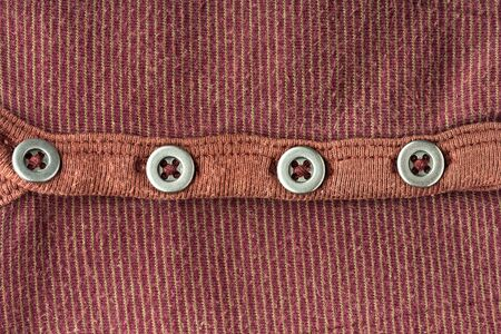 t short: Brown jacket background with four buttons