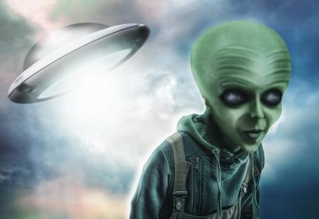 alien planet: Alien and UFO over dark background Stock Photo