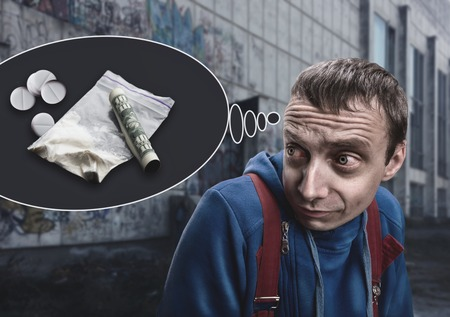 Addict is thinking about drugs in the street Stock Photo