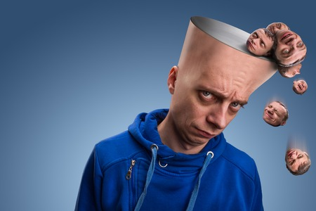 distrustful: Pensive man with many various expressions little heads falling from his head Stock Photo