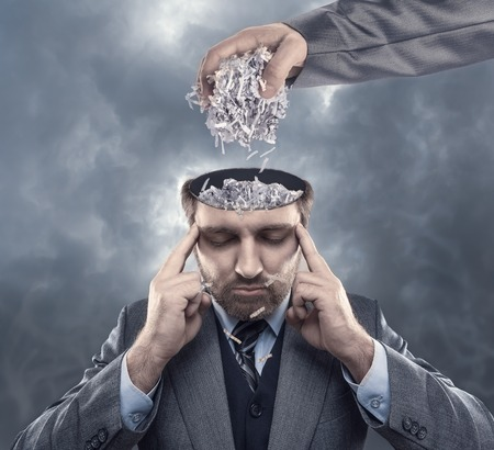 open brain: Man with shredded paper in his brain Stock Photo