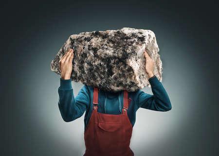 odd jobs: Man with a big rock insread of his head