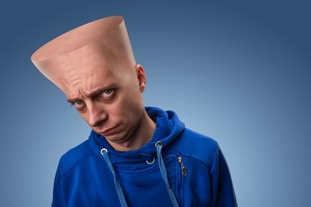 distrustful: Strange man with a big flat head over blue